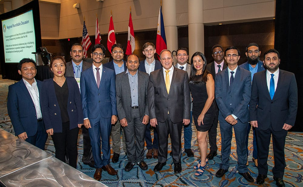 Group of international otolaryngologists posting together at International General Assembly